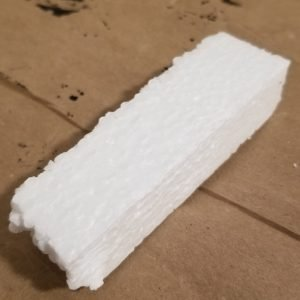 Raw styrofoam piece for a 1 inch by 2 inch modular dungeon tile