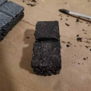 1 inch by 2 inch modular styrofoam dungeon tile with black Mod Podge base coat to seal and strengthen the foam